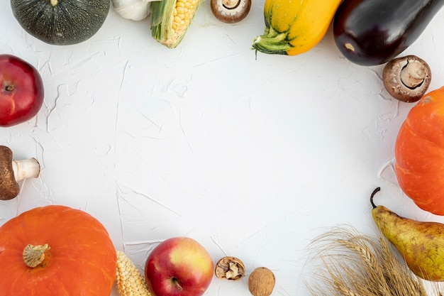 Top view autumn fruits and vegetables with copy space