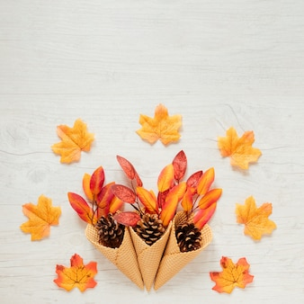 Top view autumn leaves in ice cream cone