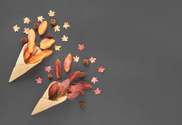 Top view autumn leaves in ice cream cones