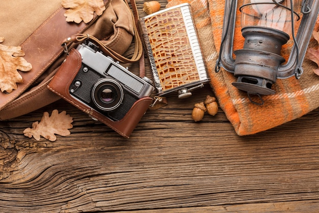 Top view of autumn leaves with camera and lantern
