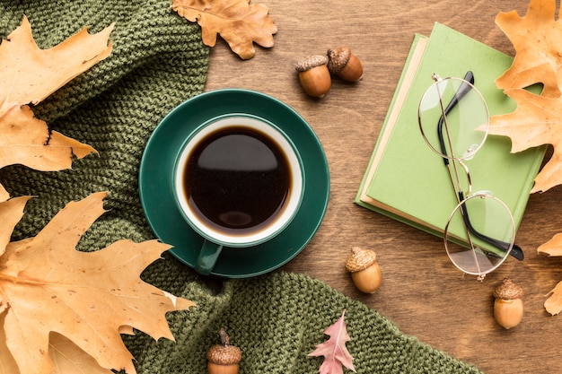 Top view of autumn leaves with coffee and glasses