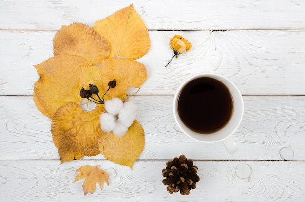 Top view autumn leaves with coffee