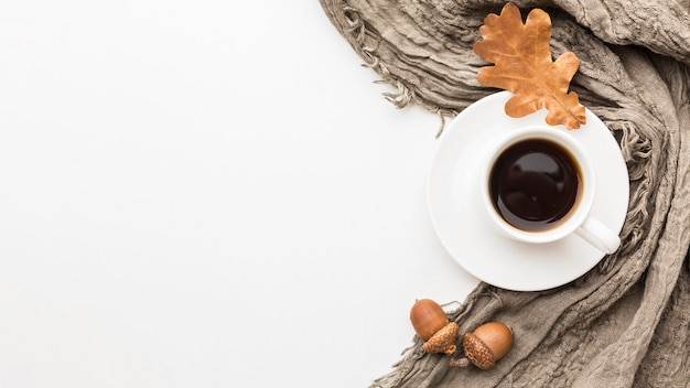 Top view of autumn leaves with copy space and coffee