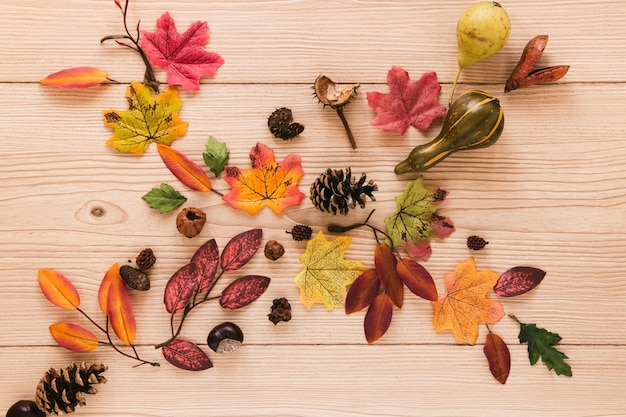 Top view autumn leaves on wooden table