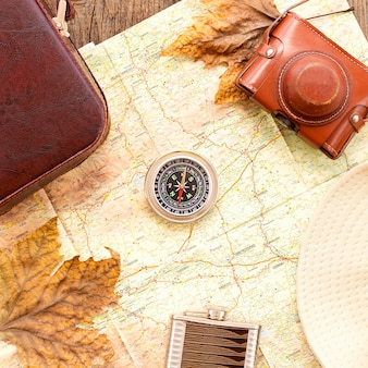Top view autumn traveling arrangement with compass