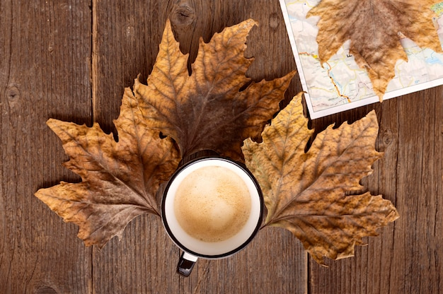 Top view autumn traveling arrangement with cup of coffee
