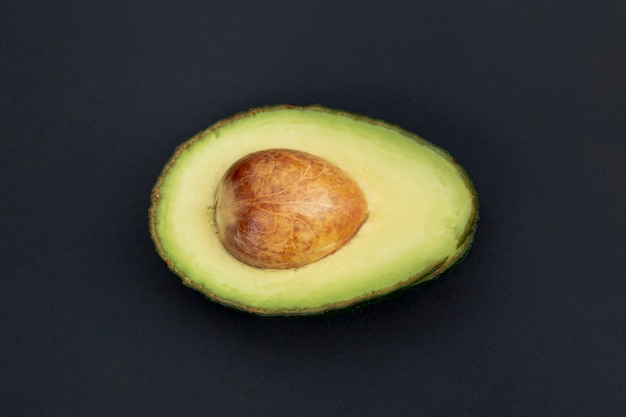 Top view of avocado half with pit
