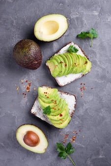 Top view of avocado toast with herbs and spices