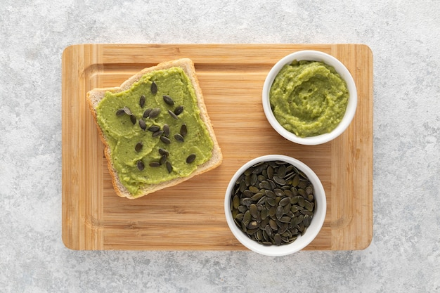 Top view avocado toast with seeds on cutting board