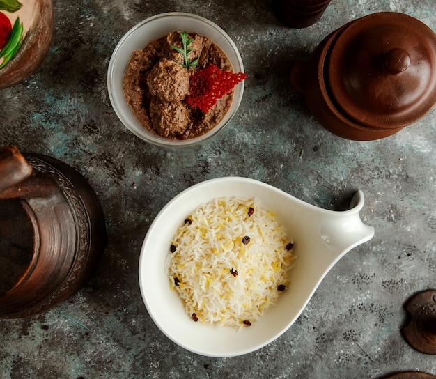 Top view of azerbaijani pilaf rice and meatballs
