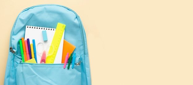 Top view of back to school stationery with backpack