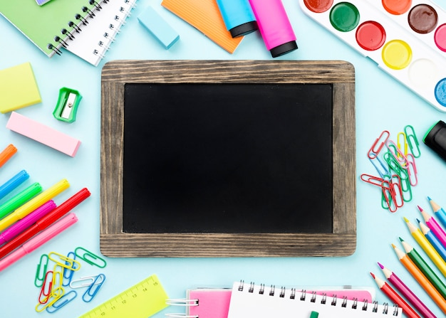 Top view of back to school stationery with blackboard