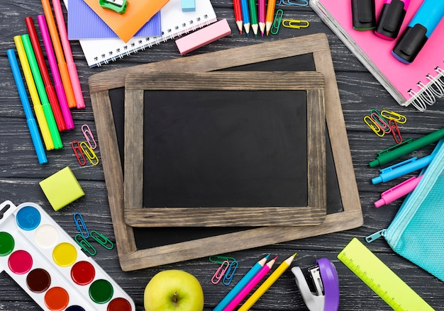 Top view of back to school stationery with blackboards