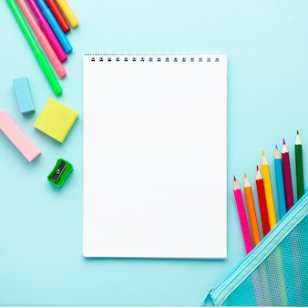 Top view of back to school stationery with notebook and pencils
