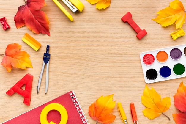 Top view of back to school supplies with watercolor and stapler