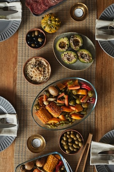 Top view background image of delicious homemade food on autumn dinner table,