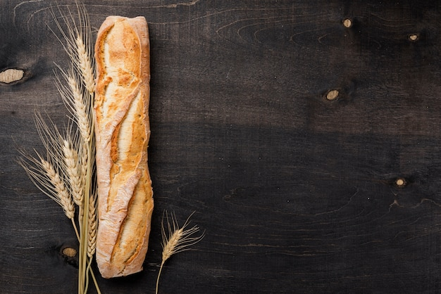 Top view baguette french bread with wheat and copy space