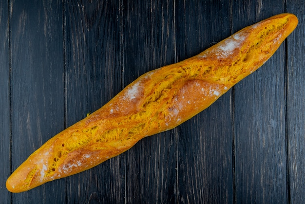 Top view of baguette on wooden