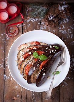 Top view of baked aubergines with tomatoes