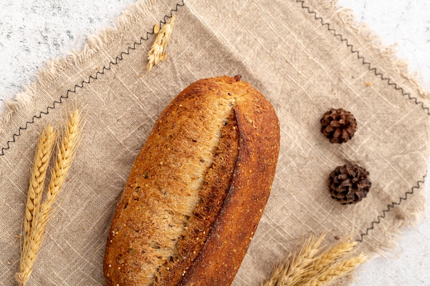 Top view baked bread on burlap fabric