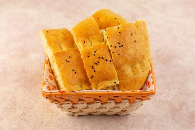 A top view baked bread hot tasty fresh sliced inside bread bin on pink