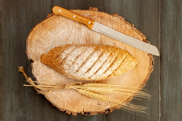 Top view baked bread with knife