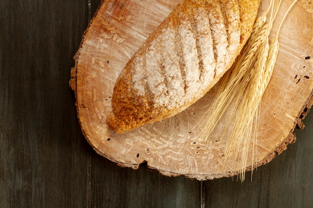 Top view baked bread on wooden board