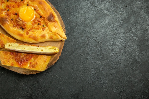 Top view baked egg bread delicious fresh off the oven on a dark grey space