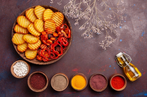 Top view baked potatoes with different seasonings on dark-purple space