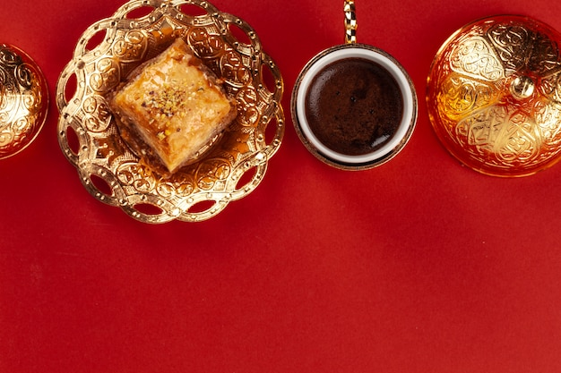 Top view of baklava and coffee in oriental dishware