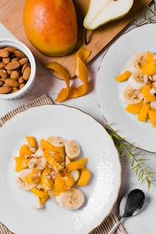 Top view of banana and mango on plates