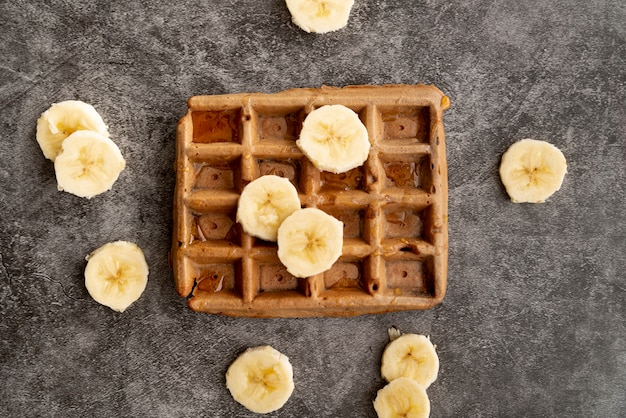 Top view of banana slices on top of waffle