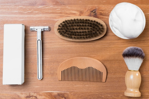 Top view barber shop and wooden comb