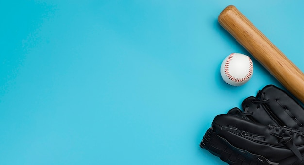 Top view of baseball bat with ball and gloves