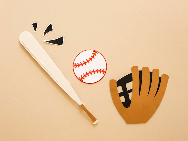 Top view of baseball bat with glove and ball