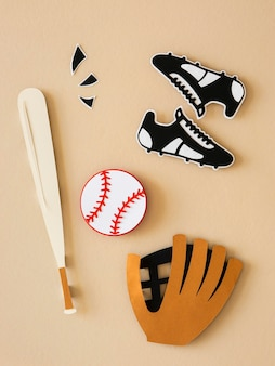 Top view of baseball bat with sneakers and glove