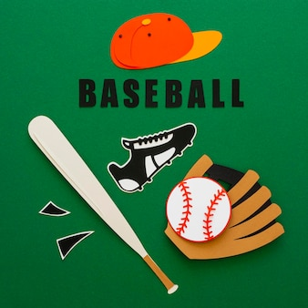 Top view of baseball with bat, sneaker and cap