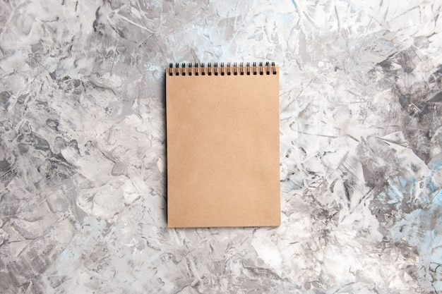Top view basic notepad on white table copybook notepad