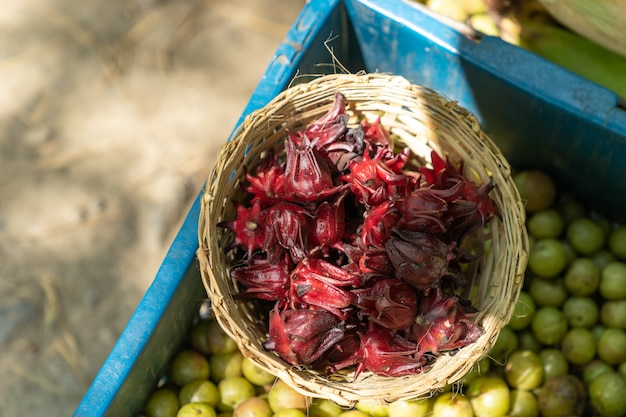Top view of a basket of fresh roselle  at fresh local market