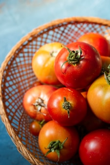 Top view basket full with tomatoes