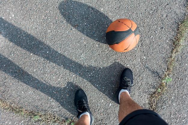 Top view basketball on asphalt