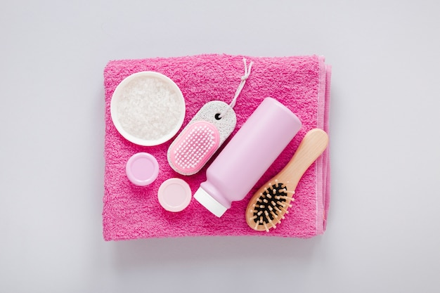Top view of bath products on pink towel