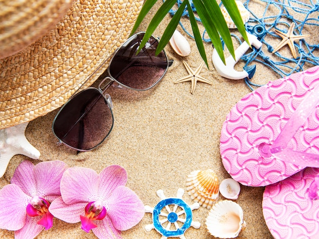 Top view of beach accesories on sands with copy space