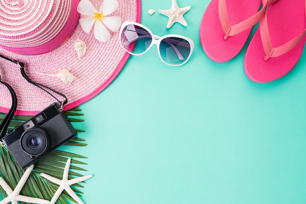 Top view of beach accessories for summer holiday and vacation concept.