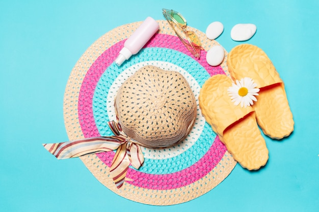 Top view of beach set, woman summer hat and other
