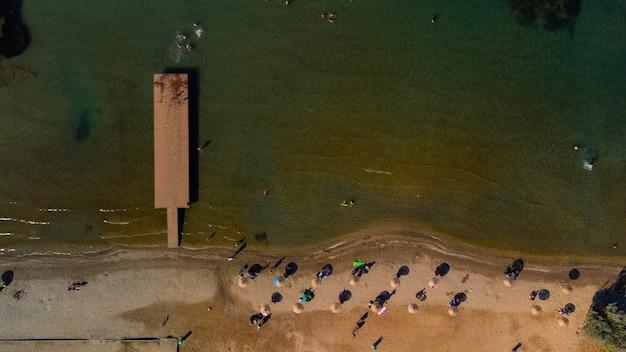 Top view of beach with umbrella. golden sands, izmir, turkey. high quality photo