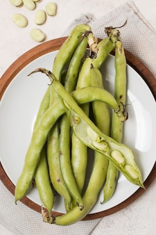 Top view of beans with garlic on plate