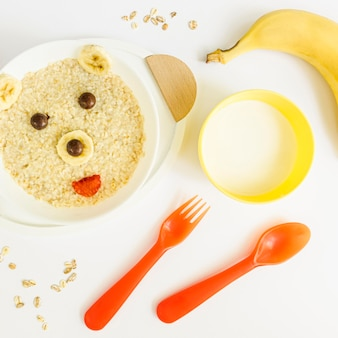 Top view bear shape cereals with banana