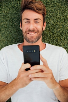 Top view bearded man holding phone