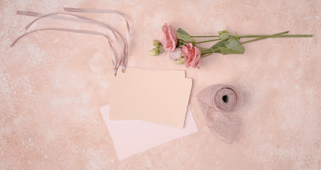 Top view beautiful decoration with wedding invitations